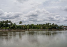 The Mae Klong river in Thailand. The Mae Klong is a river in western Thailand that begins at the confluence of the Khwae Noi and the Khwae Yai River in royalty free stock photos