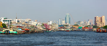 Mae Nam Chao Phraya (Eng. The river of Kings) river with water public transport and different vessels. Bangkok, Thailand. Stock Images