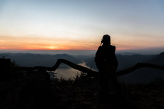 Mae Ping river view point. Silhouette woman standing and seeing lake and mountain at sunrise Stock Photos