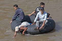 MAE SOT, THAILAND NOV 12TH: Burmese crossing the Moei river on a Royalty Free Stock Image