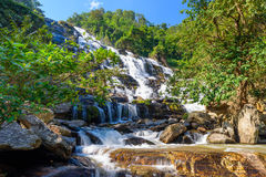 Mae Ya waterfall with green trees and blue sky backgroundat Doi Inthanon National Park,One of the famous waterfalls Royalty Free Stock Photography