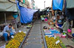 MAEKLONG, THAILAND-DECEMBER 11,2016 : The famous railway market or folding umbrella market at Maeklong, Thailand, A famous market Stock Image