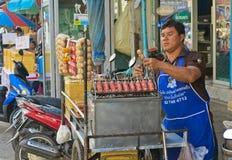 MAEKLONG, THAILAND-DECEMBER 11,2016 : Traditional Thai Food, E-san Sausage Northeastern Thai Style, Grill E-Saan Sausage on steel Royalty Free Stock Photo