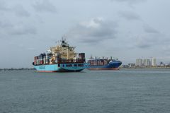 Maersk line cargo ship arrives Nigeria port  while Leto Monrovia exit in a , typical import & export concept royalty free stock images
