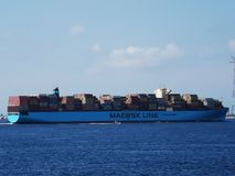 Maersk Line ship container carrier. Maersk Line shipping company container carrier passing the sea in the Strait of Messina, Italy stock image