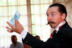 Maestro Magician Illusionist Does Show On The Interior Design Scene. Royalty Free Stock Photography