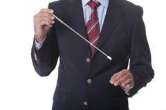Maestro que dirige a una orquesta Foto de archivo libre de regalías