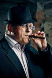 Mafia boss with cigar Stock Photography
