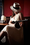 Mafia bride. With hat holding a machine-gun Stock Photography