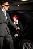 Mafia Chick Getting Out Of The Car Stock Image