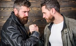 Mafia dealer. Real friendship of mature friends. Male friendship concept. Brutal bearded men wear leather jackets. Shaking hands. Real men and brotherhood royalty free stock image