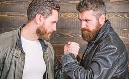Mafia dealer. Real friendship of mature friends. Male friendship concept. Brutal bearded men wear leather jackets. Shaking hands. Real men and brotherhood royalty free stock images