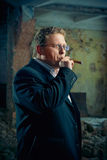 Mafia (gangster) boss smoking cigar Stock Photo