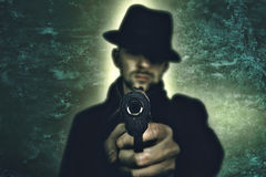 Mafia gangster. Gangster with hat pointing his gun stock image