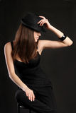 Mafia Girl in a black dress with a hat Royalty Free Stock Images
