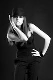 Mafia Girl in a black dress with a hat Stock Photo