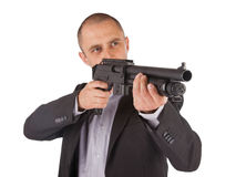 Mafia man is holding a shotgun Stock Photography