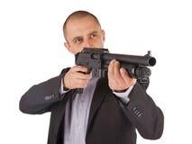 Mafia man is holding a shotgun Stock Photography