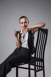 Mafiosi woman with brandy. Fashion photo Stock Images