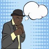 Mafioso dans le chapeau écoutant les actualités Image stock