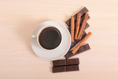Mag and chocolate on wood. Coffee cup and chocolate on wood background Royalty Free Stock Photo