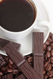 Mag of coffee and chocolate. Coffee cup and chocolate on a white background Stock Photo