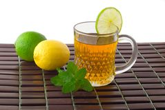 Mag of green tea with lemon, lime and mint. Stock Photo