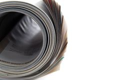 Mag roll. Close up rolled up magazine Stock Image