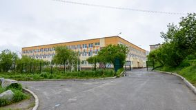 Architecture of Magada, Russian Federation. MAGADAN, RUSSIA - JUL 4, 2014: Primary school number 30 in Magadan, Russia. Magadan was founded in 1929 and now it's royalty free stock photo