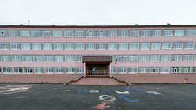 Architecture of Magada, Russian Federation. MAGADAN, RUSSIA - JUL 4, 2014:Primary school in Magadan, Russia. Magadan was founded in 1929 and now it's the stock photo