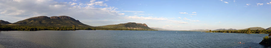 The Magaliesberg Mountain Range over the waters of the Hartbeesp. Oort Dam, not far from Pretoria and Johannesburg Royalty Free Stock Image