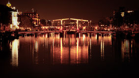 Magare Brug. Amsterdam's famous Magare Brug aka Skiny Brridge at night stock images