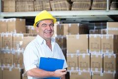 Magasinier au travail dans l'entrepôt Photo libre de droits