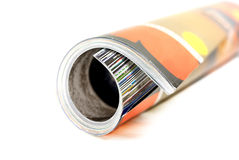 Magazine. Rolled-up color magazine isolated over white background Royalty Free Stock Photography