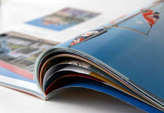Magazine. The opened magazine. Focus on an upper edge of pages Stock Photos
