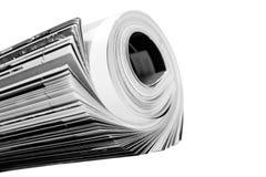 Magazine. Rolled up magazine over white Royalty Free Stock Photography