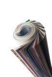 Magazine. Roll up, white background isolate Royalty Free Stock Photos