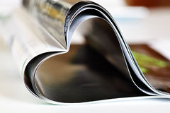 Magazine. Folded to heart shape on table Royalty Free Stock Images