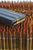 Magazine on ammo. M-16 type magazine on top of .223, .243, and 300 win mag ammo Royalty Free Stock Photography