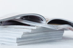 Magazine blur on a wooden table. Stock Photography