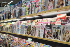 Magazine and cleaning product inside supermarket Royalty Free Stock Images