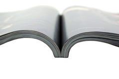 Magazine close-up isolated on white background. Stock Photos
