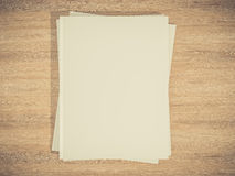 Magazine cover with blank white page mockup on vintage wooden substrate Stock Image