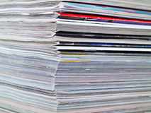 Magazine Edge Stacked Full Frame. A stack of magazines filling the frame from top to bottom focus on corner edge Royalty Free Stock Photography
