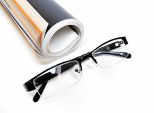 Magazine with glasses Stock Photography