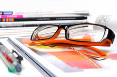 Magazine with glasses Royalty Free Stock Photo