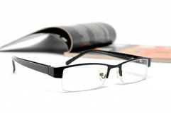 Magazine and glasses Stock Photography
