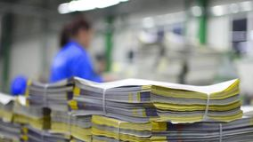 Magazine print stuck in production line stock video footage