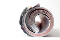 Magazine roll. On white background royalty free stock photos
