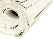 Magazine Roll. Roll of magazines isolated on a white background Royalty Free Stock Photography